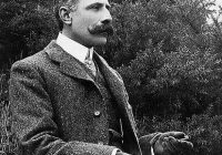 Photograph of Edgar Elgar sat outside dressed formally