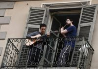 Two Italian Musicians playing on their balcony whilst quarantined due to the Coronavirus