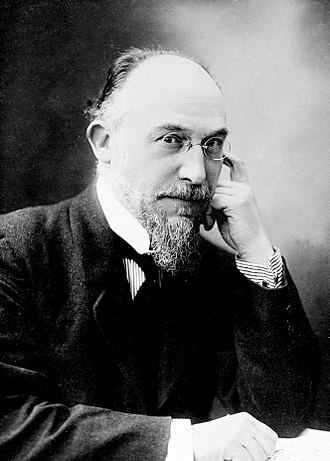 Black and white photo of Eric Satie in his later years