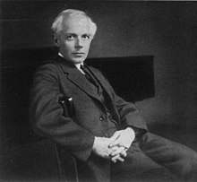 Black and White photo of Bela Bartok in his mid-forties sat in a chair