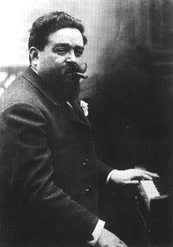 Black and white photograph of Isaac Albeniz at the piano aged 41