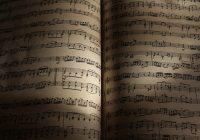 an open book with sheet music