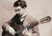 Black & White photograph of Francisco Tarrega playing the guitar